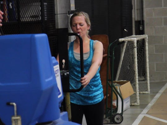 Tribune reporter Andrea Fisher-Nitschke pushes against a simulation machine while completing the MPAT at the Great Falls Police Department on June 11.
