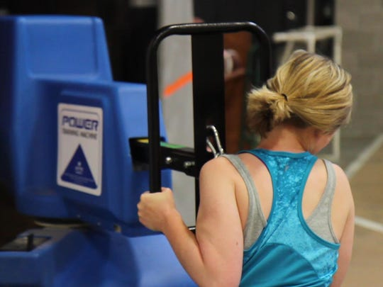 Tribune reporter Andrea Fisher-Nitschke pushes against a simulator machine while completing the MPAT at the Great Falls police Department on June 11.