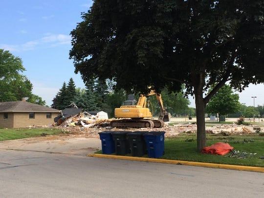 Demolition crews level a duplex on Blue Ridge Drive near Lambeau Field Monday morning.