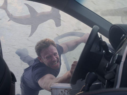 "Ian Ziering portrays Fin Shepard ""Sharknado 3: Oh Hell No!"", in which people-chomping sharks rain down on the Space Coast."