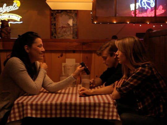 "Claire Morkin, Evan Board and Rebecca Weaver (aka Rebecca Livengood), from left, in a scene from Weaver's feature-length movie ""June Falling Down,"" which has its premiere Saturday night at Camp David in Fish Creek."