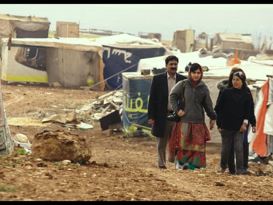 "Ziauddin Yousafzai and Malala Yousafzai and Syrian refugee Rimah in ""He Named Me Malala."""