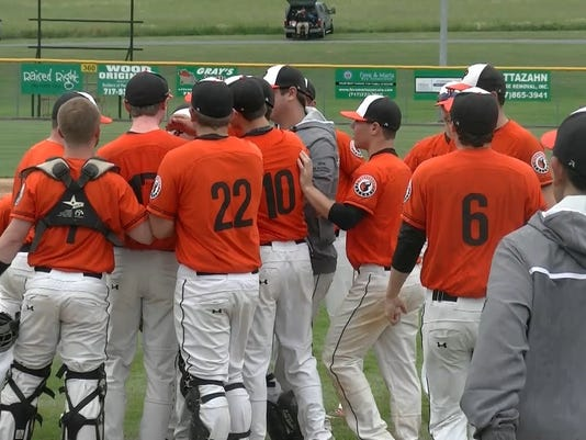 Pennsbury players surround pitcher Logan Buell after the Falcons 2-0 win over Hempfield on Wednesday, June 3, 2015.