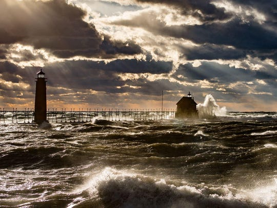 Ed Post's photos of a wind whipped Lake Michigan crashing into the Grand Haven Lighthouse on Thursday.