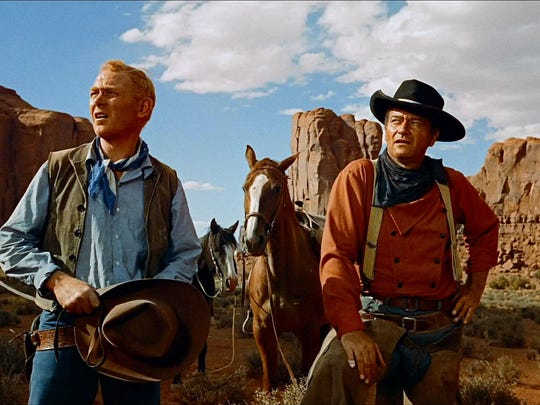 "Harry Carey Jr. (left) and John Wayne in ""The Searchers."""