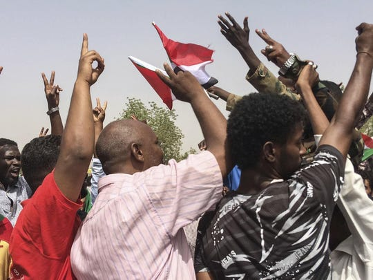 Sudanese celebrate after officials said the military