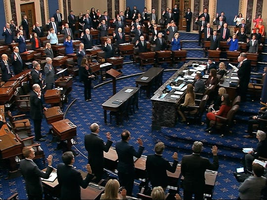 FILE - In this Jan. 16, 2020, image from video, presiding officer Supreme Court Chief Justice John Roberts swears in members of the Senate for the impeachment trial against President Donald Trump at the U.S. Capitol in Washington. No cell phones. No talking. No escape. One-hundred U.S. senators will soon be stationed at wooden desks, under the threat of imprisonment, as they silently listen to the arguments in the impeachment trial of President Donald Trump. While senators groan about the restrictions _ and will likely violate them at times _ they say the long-standing rules are crucial as they execute their most solemn duty: considering whether to remove the president of the United States. (Senate Television via AP, File)