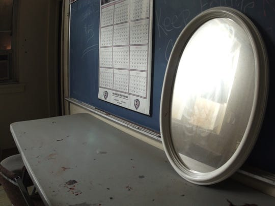 Barnegat, NJ. Tuesday 9/30/14. A lone mirror sits on a desk at the abandoned Elizabeth V. Edwards school.  Urban legend claims the building is haunted. Staff photo by: Brian Johnston Asbury Park Press, Video available.