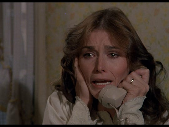 Margot Kidder as Kathy Lutz has a little problem with