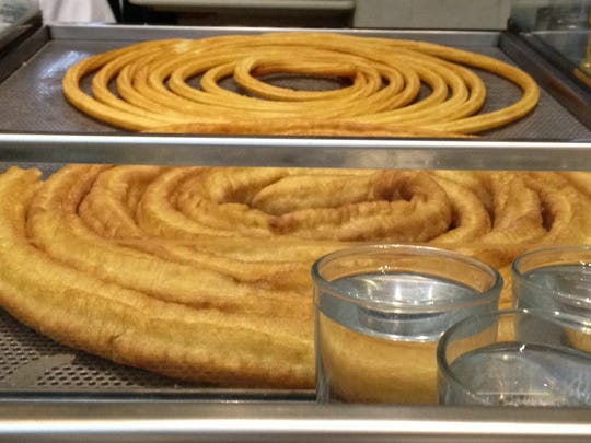The rope-like churros at San Gines Chocolateria. To make churros, you have to pipe them out of a pastry bag directly into the hot oil.
