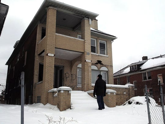 """""""Internal Combustion"""" director Steve Faigenbaum in front of his grandfather's apartment on Elmhurst in Detroit."""