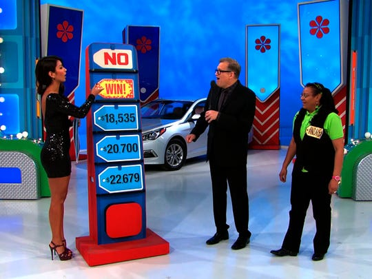 "Manuela Arbelaez, left, ensured the price was right ... on the game show ""The Price is Right."" Show host Drew Carey is center; the contestant is right."