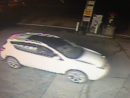 In this security footage screen shot, a white SUV, driven by an unidentified homicide suspect, flees the Shell gas station parking lot last Wednesday. Police say one of the occupants of this vehicle shot Conrado Pizarro, 26, killing him. Security cameras at the gas station captured the killing.