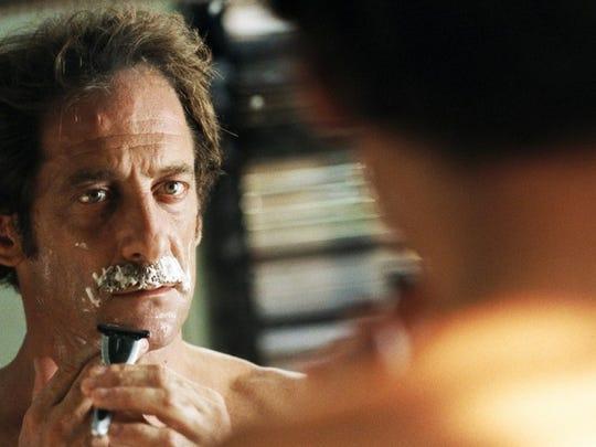 """A film still from the 2005 film """"La Moustache."""" The"""