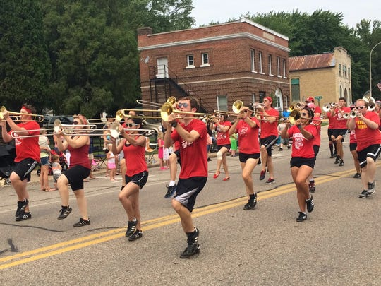 Members of the University of Wisconsin Marching Band march through downtown Amherst on Saturday as part of the Amherst Fair's annual parade.