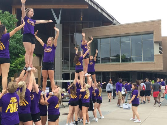 Members of the UWSP co-ed cheerleading team welcome students to the Dreyfus University Center for the welcome picnic following Friday's convocation ceremony on campus.