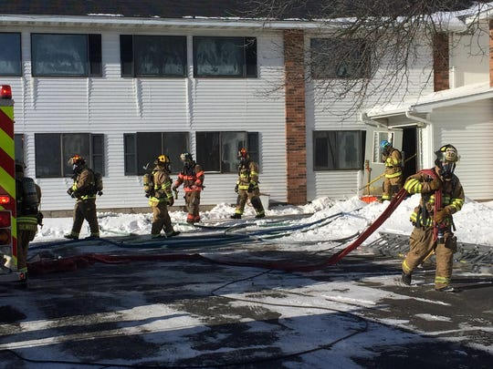 Firefighters come in and out of the Elizabeth Inn and Convention Center after a fire started in one of the rooms in the hotel on Monday morning.
