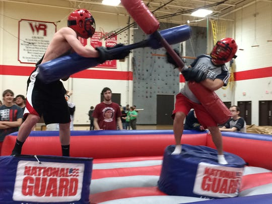 Austin Glinski, 15, left, and Yee Leng, 16, have some fun Wednesday, March 4, 2015, in the pugil pit provided by the Army National Guard in the Lincoln High School field house.