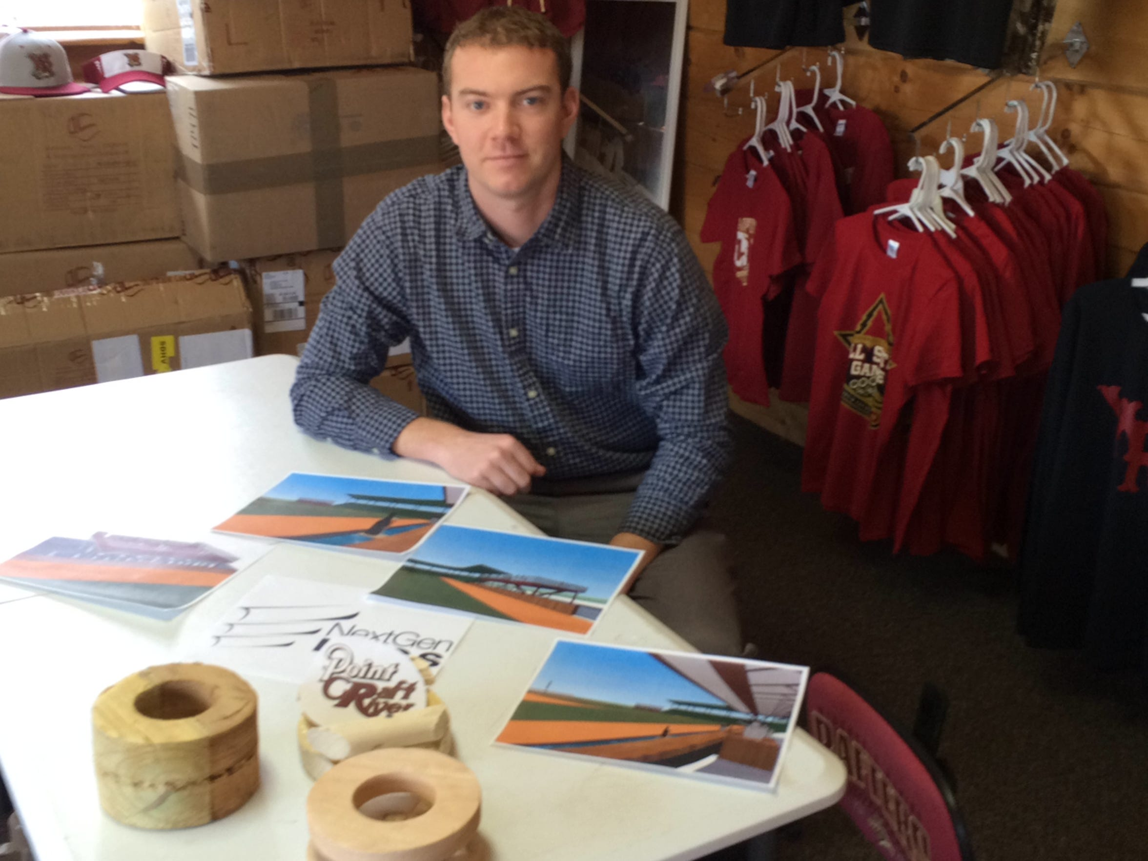 John Fanta, general manager for the Wisconsin Rapids Rafters, shows graphics and log raft prototypes for the new feature, Point Craft River, to be installed at Witter Field.