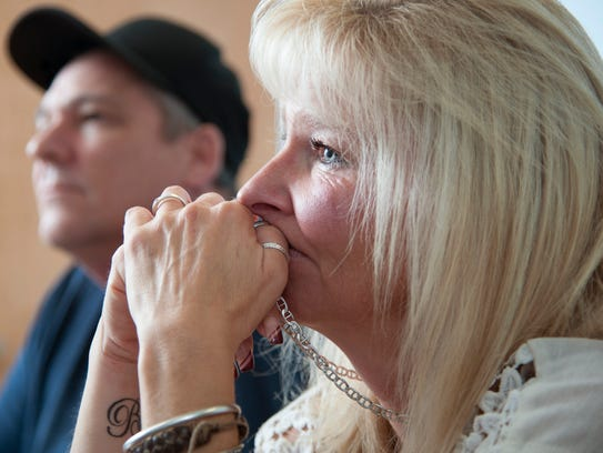 Denise Streahle of Magnolia holds the wedding ring and chain of her late husband Jim, who passed away on April 7, as Streahle sits next to her brother Frank Chisholm of Somerdale while they talk about the life and death of Jim at Samaritan Healthcare & Hospice in Marlton.