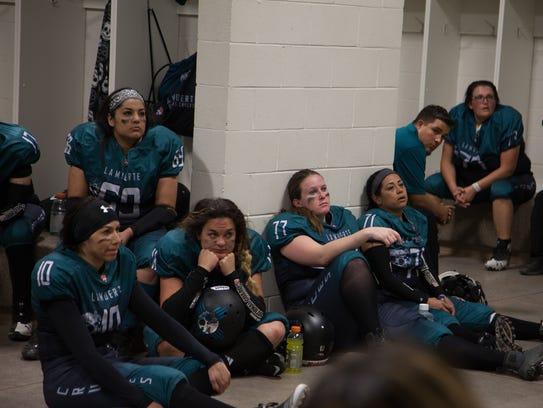 The La Muerte football team rests in the locker room