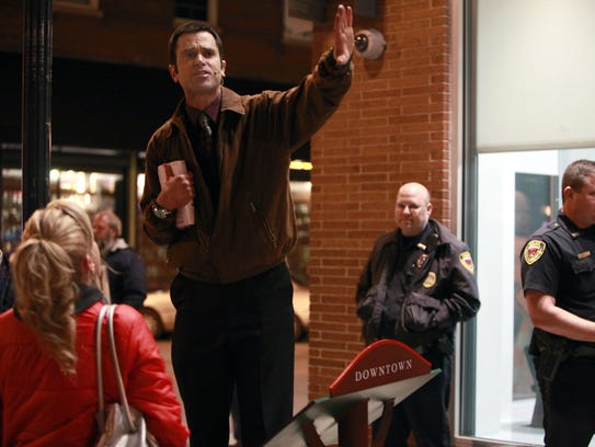 Downtown street preacher Aaron Brummitt uses a battery-powered amplifier to preach to passers-by in 2013. Brummitt and the city reached an agreement after he received repeated citations and warnings for violating the noise ordinance.