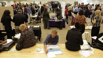 Jobseekers look for employment at a jobs fair at the Woodlawn Community Center. Tuesday March 23, 2010. Ohio's unemployment raised to 5.2 percent in April.