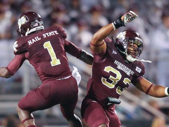 Mississippi State WR Chad Bumphis and LB Jamie Jones celebrate during the 2011 Egg Bowl. MSU won 31-3.