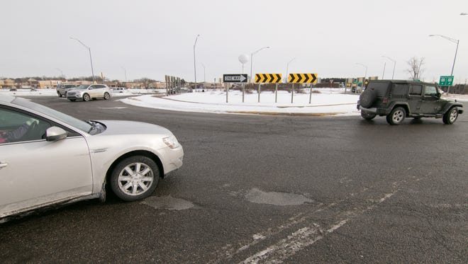 Cars approach the western end of the Lee Road roundabouts in Green Oak Township from a number of directions Thursday, Dec. 28, 2017. The Livingston County Road Commission will reduce lanes in the roundabout to reduce crashes.