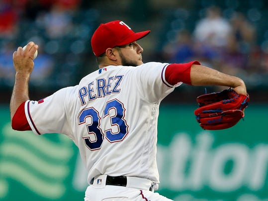 Texas Rangers starting pitcher Martin Perez (33) throws to the Seattle Mariners in the first inning of a baseball game, Wednesday, Sept. 13, 2017, in Arlington, Texas. (AP Photo/Tony Gutierrez)