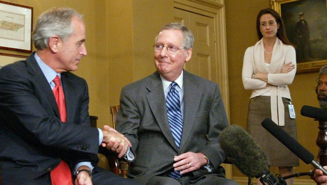 """Sen. Mitch McConnell, right, greets Bob Corker in Washington on Nov. 14, 2006. McConnell praised the retiring senator on Thursday, saying, """"He's a powerful voice for American interests and those of our allies and a forceful, influential thorn in the side of those who might wish us harm."""""""