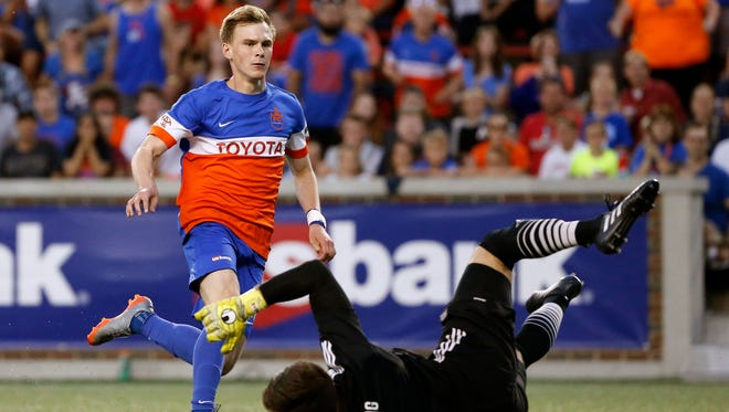 FC Cincinnati's Jimmy McLaughlin (20) shoots past Ottawa goal keeper Callum Irving (1) for a goal in the first half of the USL soccer match between FC Cincinnati and the Ottawa Fury at Nippert Stadium in Cincinnati on Wednesday, Aug. 23, 2017. FC Cincinnati secured a 3-1 win over Ottawa before more than 20,000 fans.