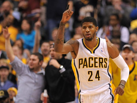 Indiana Pacers forward Paul George celebrates a fast break basket and dunk against the Brooklyn Nets during the second half, December 28, 2013, at Bankers Life Fieldhouse.