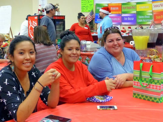 Happy shoppers from Ruidoso enjoyed the food court during a break.