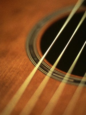Learn guitar, from acoustic to electric, at summer camp.