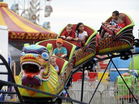 Kids ride the Orient Express last year at the Santa Rosa County Fair in Milton. The 24th annual fair kicks off Friday with more rides, vendors and exhibits than ever at its newly-expanded location. Gates open at 5 p.m., and the fair runs through April 11 (closed April 6-7).
