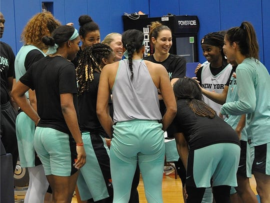 NY Liberty coach Katie Smith and players laugh with Sugar Rodgers, right, during a practice break, May 16, 2018