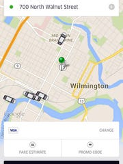 This screen grab shows Uber cars available in the area.