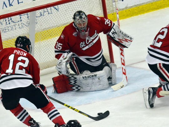 St. Cloud State's Ethan Prow (12) tries to get the