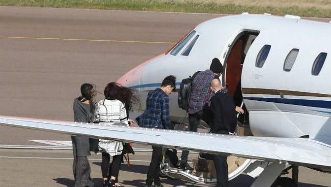 Zayn Malik boarding jet