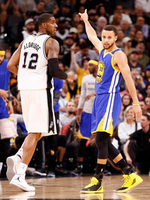 Steph Curry and the Warriors beat LaMarcus Aldridge and the Spurs for the first time this sseason.