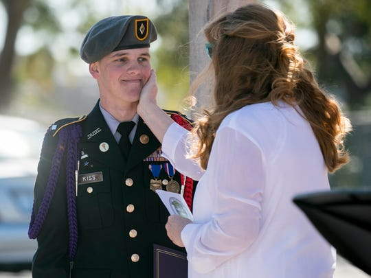 Beth Haely congratulates Caleb Kiss after he was named the recipient of the Cpl. Thomas Jardas Annual Scholarship on Sunday, January 14, 2017, at Cypress Lake High School in Fort Myers. Haely is the mother of Cpl. Thomas Jardas, a Marine who was killed in a helicopter collision off the north shore of Oahu in 2016.
