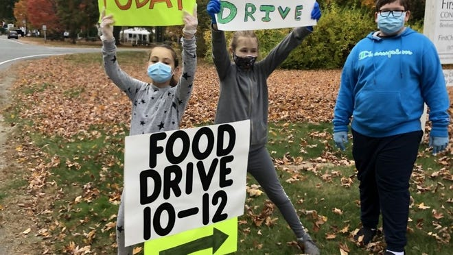 Matt Donnell, Lilly Oldakowski, and Ava McIsaac, who are all fourth-grade students at Spofford Pond School in Boxford, worked at the recent food drive at the First Congregational Church.