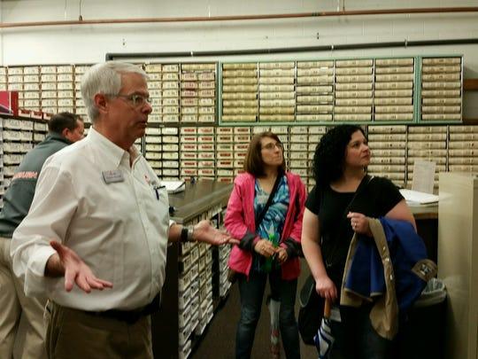 Chuck Stinnett leads the HLI class along a history tour through Henderson on Friday.