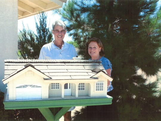 Crash victim Johannes Gysen poses with his wife, Ingeborg, and a birdhouse he designed as a scale model of their house in Yucca Valley. Gysen was killed on Highway 62 on Feb. 18, 2011, five months after this photo was taken.