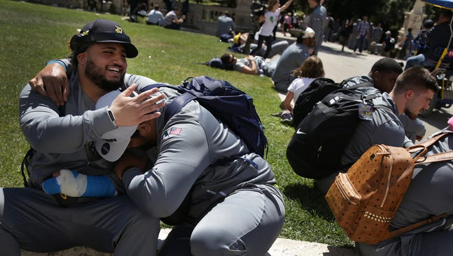 University of Michigan football players Salim Makki, left, and Bryan Mone share a laugh at Villa Borghese on their first day in Rome on Sunday, April 23, 2017.