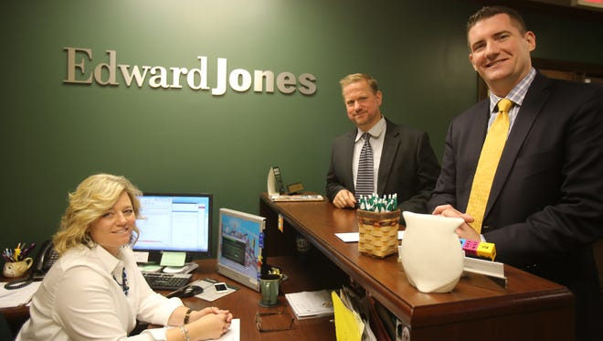 The Edward Jones branch office in Plymouth is staffed by administrator Missy Wolschleger, from left, and financial advisers Randall Cope and Chris Hamilton.