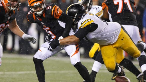 Former Alabama quarterback AJ McCarron loses the ball for the Cincinnati Bengals in Saturday night's playoff loss to the Pittsburgh Steelers.