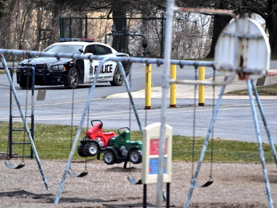 A police car is parked outside Canadochly Elementary