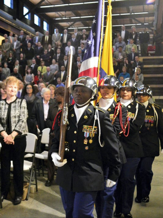 Dr. Carol Saylor, has been named chief recovery officer of the York City School District, left, looks on as the William Penn JROTC Color Guard presents the colors at the State of the City Address held Thursday evening, April 23, 2015, at LSC Design. Randy Flaum photo - raflaum@comcast.net
